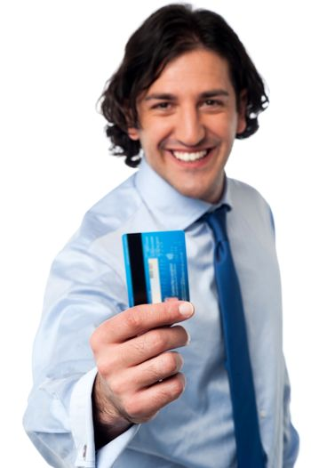 Businessman showing his credit card