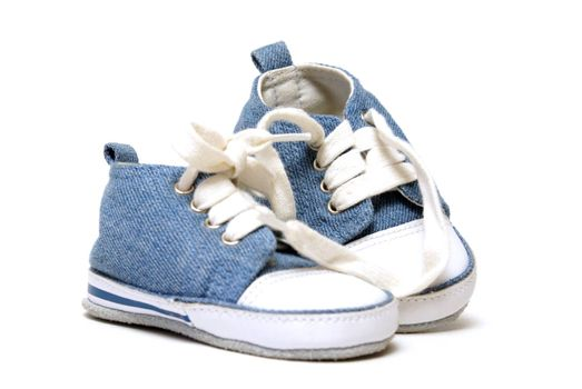 A pair of denim baby shoes for the toddlers feet.