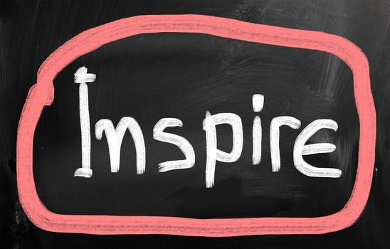Inspire handwritten with chalk on a blackboard