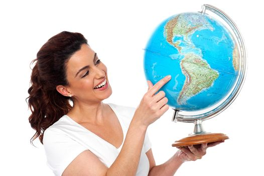 Woman holding globe in her hand