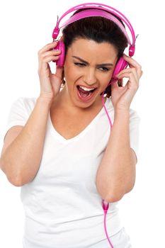 Brunette women enjoying rocking with loud music