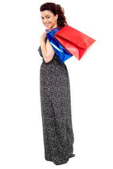 Full length portrait of shopaholic woman