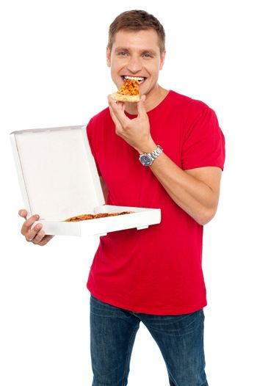 Cool young guy enjoying pizza