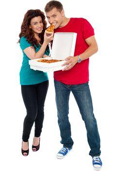 Couple enjoying pizza together, great bonding