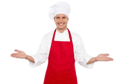 Joyful chef welcoming his guests