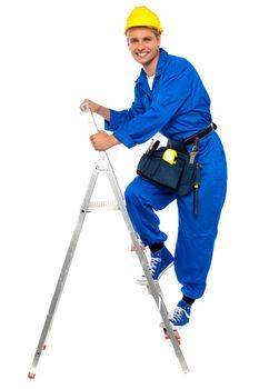 Repairman climbing up a stepladder