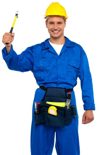 Smiling young repairman holding hammer