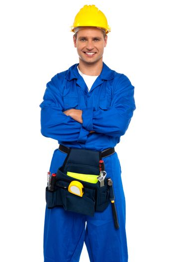 Young industrial contractor posing with crossed arms