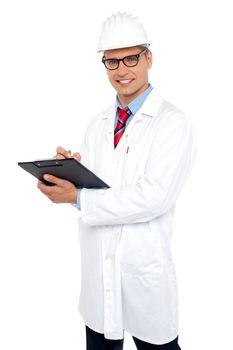 Engineer preparing report looking at you