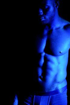 Shirtless african muscular man