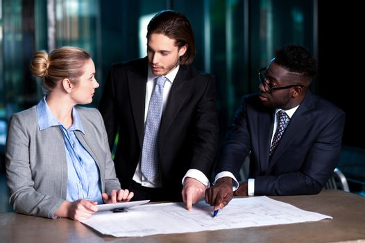 Employer explaining business plan to his colleagues