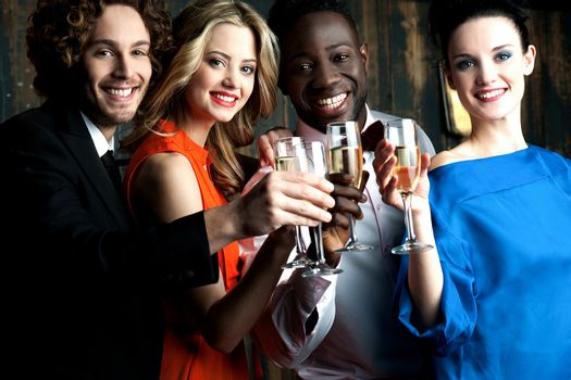 Couples enjoying champagne or wine at a party