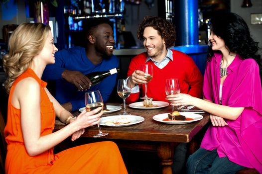 Young couples enjoying their dinner with drinks