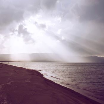 Sunbeam through the sea with retro filter effect