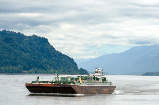 A Barge moving through the Columbia River Gorge