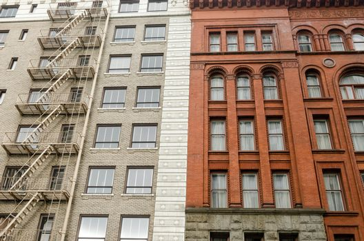 The facades of two different old different color brick buildings in downtown Portland, Oregon
