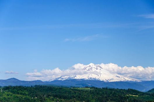 Mount Hood partially obscured by clouds