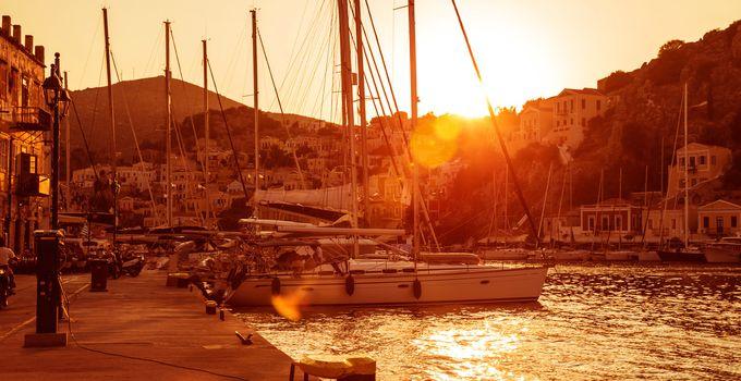 Sailboat harbor in sunset