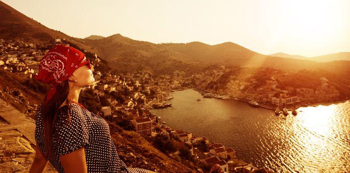 Tourist girl on sunset
