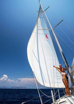Happy couple on sail boat