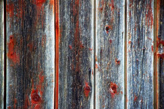 textured on red and gray  wooden surface