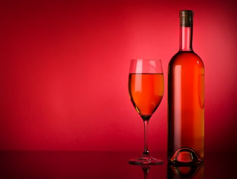 White wine on a red background