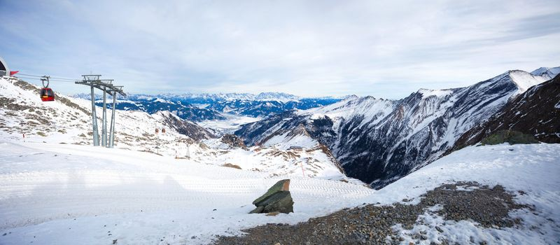 Cable car going to Kitzsteinhorn peak, panoramic view over Kaprun and Zell am See, Austria