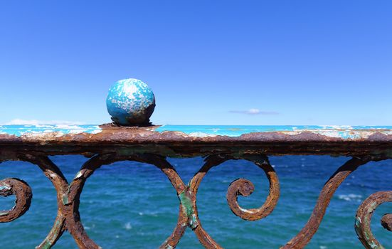 rusty balustrade on the sea front