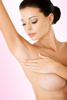 Woman's touching her armpit