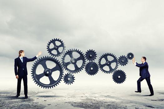 Businessmen and mechanism elements