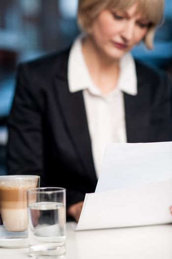 Blur image of business lady in background