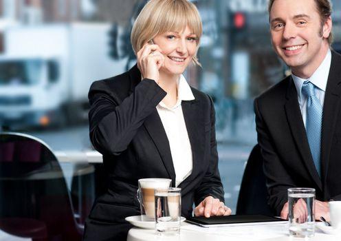 Business colleagues enjoying coffee