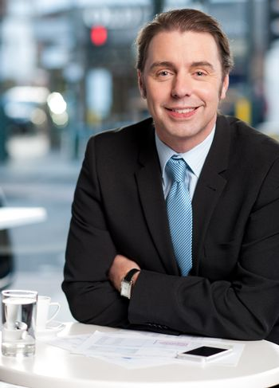 Smiling businessman at cafe