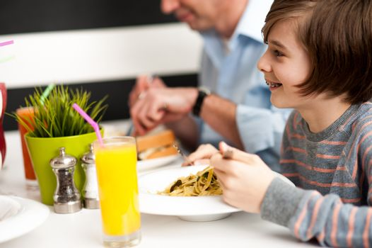 Dad and son in restaurant