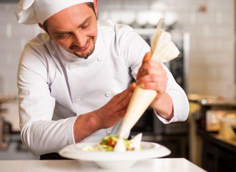 Professional chef decorating the dish