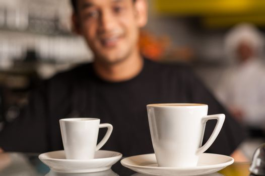 Coffee for you, restaurant staff in background