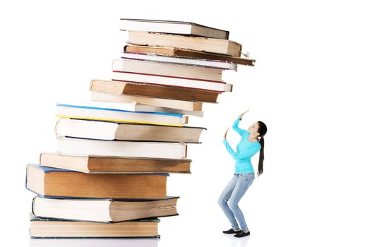 Student woman afraid of pile of books.