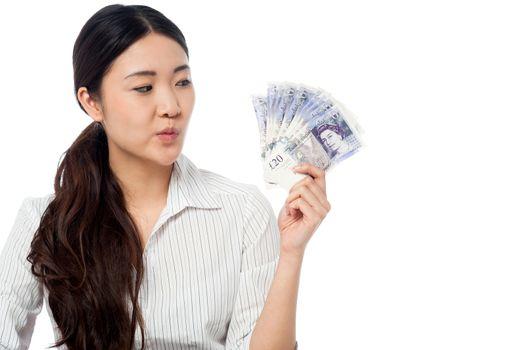 Woman holding currency fan