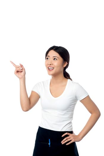 Young woman pointing and looking away
