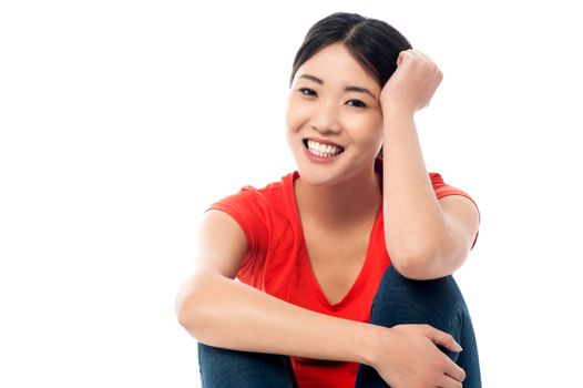 Relaxed young girl smiling while thinking something
