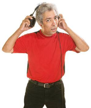 Man Removing Headphones