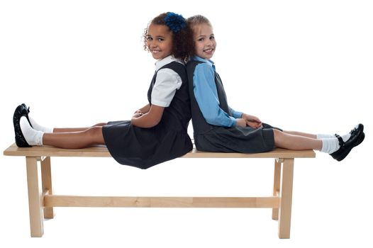 School girls leaning against each other