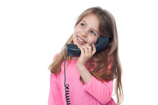 Cute girl child speaking over phone
