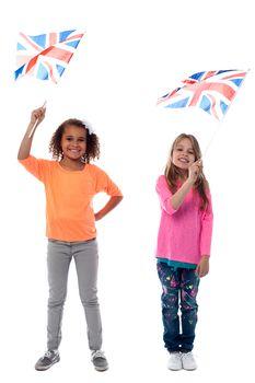 Girls waving United Kingdom flags