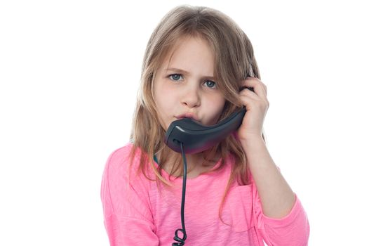 Confused girl speaking over phone
