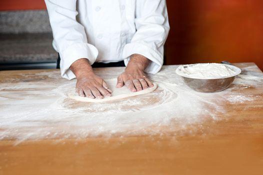 Baker kneading a dough