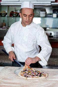 Chef busy in preparing pizza