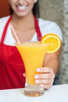 Woman serving fresh orange juice