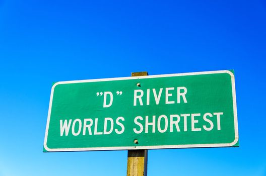 Sign in Lincoln City, Oregon for the D River, the world's shortest