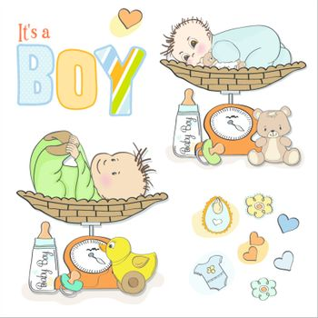 baby boy weighed on the scale, items set on white background